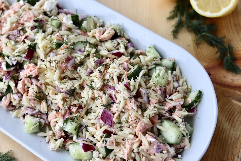 Salmon orzo salad on a plate.
