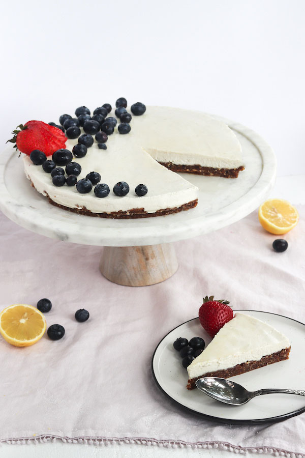 This No Bake Vegan Cheesecake has a velvety smooth, rich texture. That is the perfect balance between tangy and sweet and is free of animal products. A refreshing cold summer dessert that is decadent but not overpowering | Mealswithmaggie.com #vegancheesecake #nobakevegancheesecake #summerdessert #vegandessert #redwhiteandbluedessert #cheesecake #healthiercheesecake